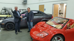 David Michery, CEO of Mullen Technologies, Inc., with Alex Ayzin, Founder of the Winds of Freedom Foundation, at the Mullen facility in Brea, California with the GT Carbon Fiber and 700e electric cars on display.