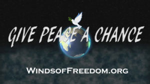 Logo of Winds of Freedom Foundation with words Give Peace a Change over a globe topped with a dove carrying an olive branch, the classic symbol of peace.
